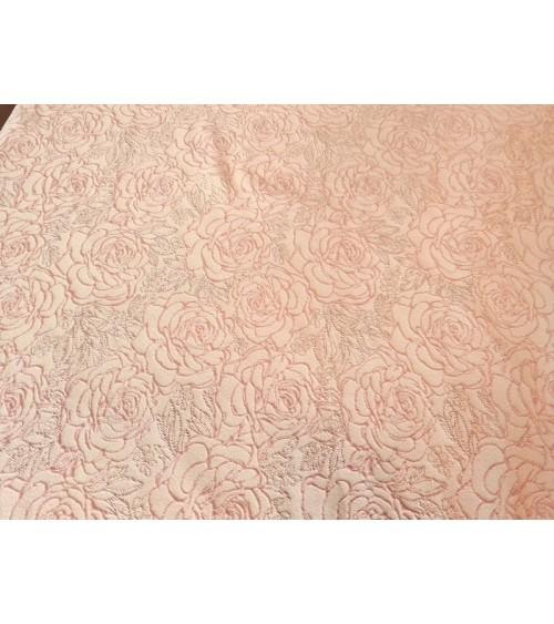 Powder colored rose figured textile
